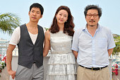 Junsang Yu Song Sunmi and Hong Sangsoo at the photo call for 'The day he arrives' during the 64th Cannes International Film Festival