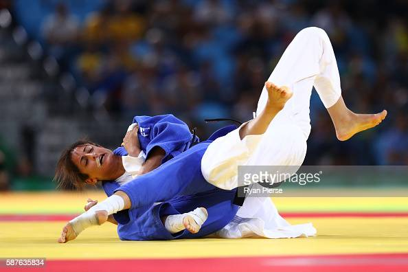 Junxia Yang of China and Yarden Gerbi of Israel compete during the Women's 63kg repechage contest bout on Day 4 of the Rio 2016 Olympic Games at the...