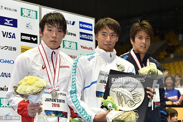 Junya Hasegawa Ryosuke Irie and Junya Koga of Japan pose on the podium after the Men's 100m Backstroke final during the Japan Swim 2016 at Tokyo...