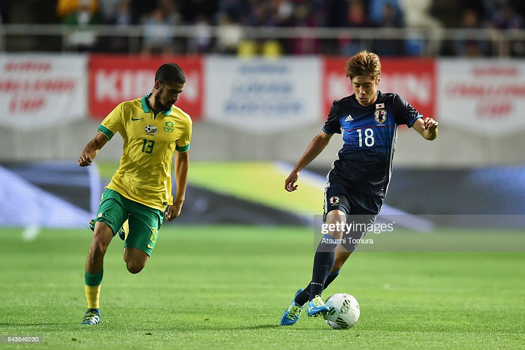 Junya Ito of Japan and Abbubaker Mobara of South Africa compete for the ball during the U-23 international friendly match between Japan and South Africa at the Matsumotodaira Football Stadium on June 29, 2016 in Matsumoto, Nagano, Japan.