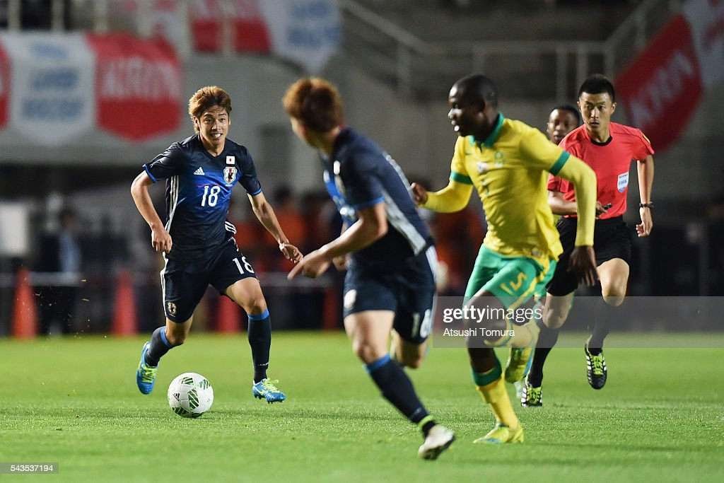 Junya Ito (L) of Japan in action during the U-23 international friendly match between Japan and South Africa at the Matsumotodaira Football Stadium on June 29, 2016 in Matsumoto, Nagano, Japan.