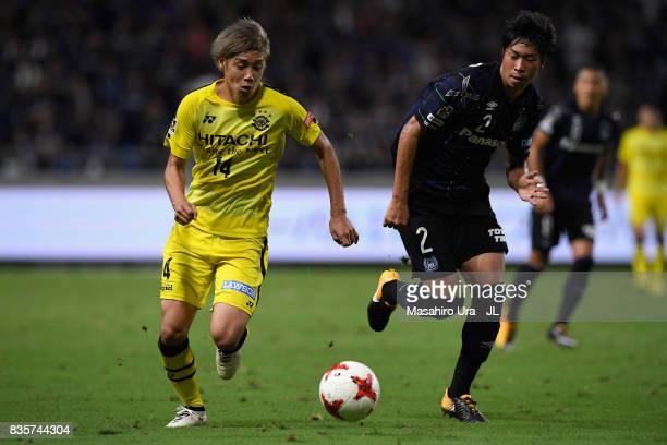 Junya Ito of Kashiwa Reysol and Genta Miura of Gamba Osaka compete for the ball during the JLeague J1 match between Gamba Osaka and Kashiwa Reysol at...