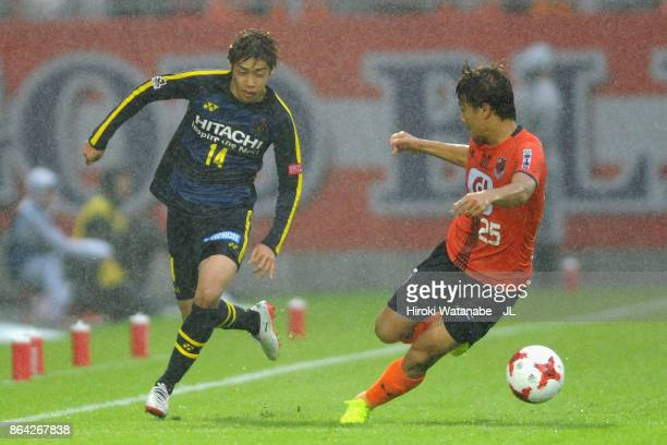Junya Ito of Kashiwa Reysol and Kazuma Takayama of Omiya Ardija compete for the ball during the JLeague J1 match between Omiya Ardija and Kashiwa...