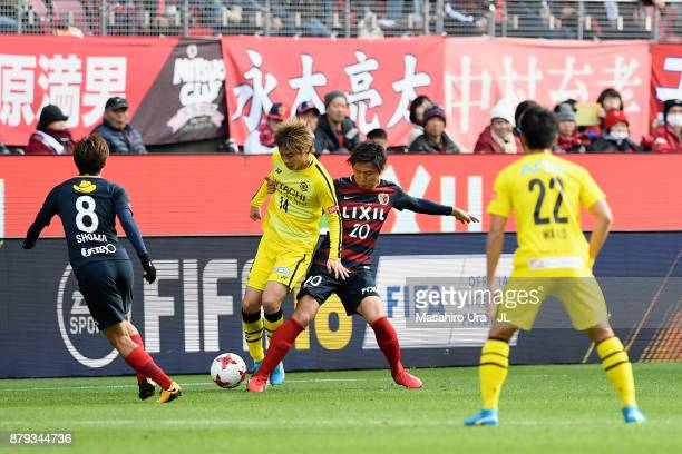 Junya Ito of Kashiwa Reysol and Kento Misao of Kashima Antlers compete for the ball during the JLeague J1 match between Kashima Antlers and Kashiwa...