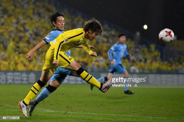 Junya Ito of Kashiwa Reysol and Koji Miyoshi of Kawasaki Frontale compete for the ball during the JLeague J1 match between Kashiwa Reysol and...