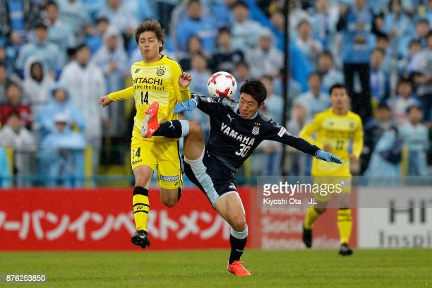 Junya Ito of Kashiwa Reysol and Rikiya Uehara of Jubilo Iwata compete for the ball during the JLeague J1 match between Kashiwa Reysol and Jubilo...