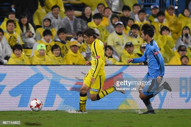 Junya Ito of Kashiwa Reysol and Shintaro Kurumaya of Kawasaki Frontale compete for the ball during the JLeague J1 match between Kashiwa Reysol and...