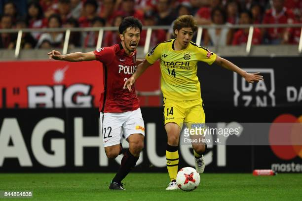 Junya Ito of Kashiwa Reysol and Yuki Abe of Urawa Red Diamonds compete for the ball during the JLeague J1 match between Urawa Red Diamonds and...
