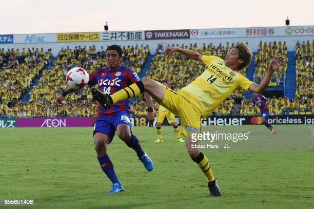 Junya Ito of Kashiwa Reysol and Yusuke Tanaka of Ventforet Kofu compete for the ball during the JLeague J1 match between Kashiwa Reysol and Ventforet...