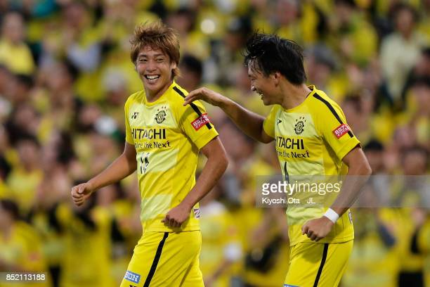 Junya Ito of Kashiwa Reysol celebrates scoring his side's second goal with his team mate Shinnosuke Nakatani during the JLeague J1 match between...
