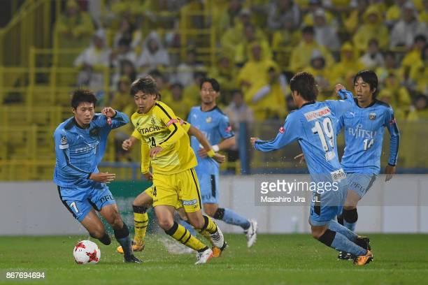 Junya Ito of Kashiwa Reysol controls the ball under pressure of Kawasaki Frontale defense during the JLeague J1 match between Kashiwa Reysol and...