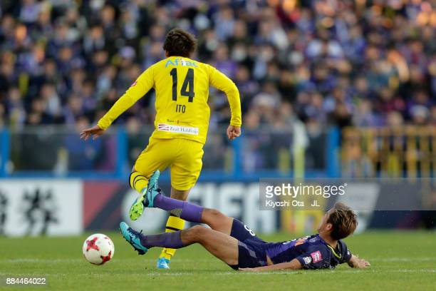 Junya Ito of Kashiwa Reysol is tackled by Yoshifumi Kashiwa of Sanfrecce Hiroshima during the JLeague J1 match between Kashiwa Reysol and Sanfrecce...