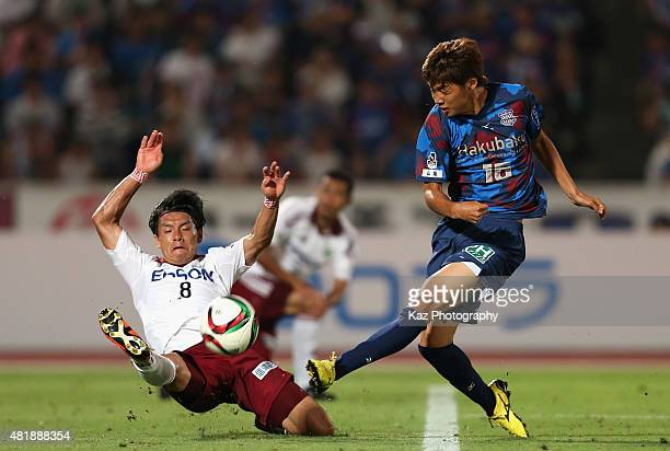 Junya Ito of Ventforet Kofu shoots at goal while Yuzo Iwakami of Matsumoto Yamaga tries to block during the JLeague match between Ventforet Kofu and...