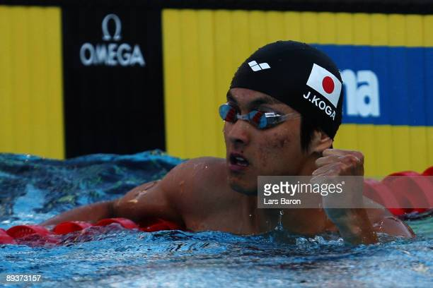 Junya Koga of Japan celebrates victory in the Men's 100m Backstroke Final during the 13th FINA World Championships at the Stadio del Nuoto on July 28...