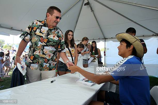IRVINE CA AUGUST 20 Junya Koga of Japan signs an autograph during the Mutual of Omaha Pan Pacific Championships at the William Woollett Jr Aquatic...