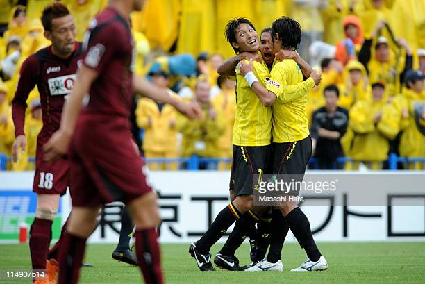 Junya Tanaka of Kashiwa Reysol celebrates first goal with teammate Leandro Domingues and Hideaki Kitajima during the JLeague match between Kashiwa...