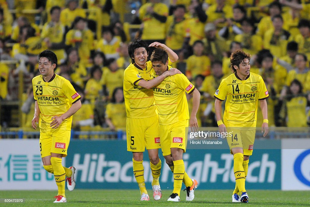 Junya Tanaka (2nd R) of Kashiwa Reysol celebrates scoring his team's first goal with his team mate <a gi-track='captionPersonalityLinkClicked' href=/galleries/search?phrase=Tatsuya+Masushima&family=editorial&specificpeople=2300918 ng-click='$event.stopPropagation()'>Tatsuya Masushima</a> (2nd L) during the J.League match between Kashiwa Reysol and FC Tokyo at the Hitachi Kashiwa Soccer Stadium on April 10, 2016 in Kashiwa, Chiba, Japan.