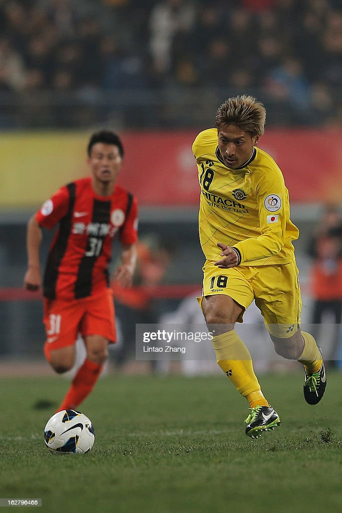 Junya Tanaka of Kashiwa Reysol controls the ball during the AFC Champions League match between Guizhou Renhe and Kashiwa Reysol at Olympic Sports Center on February 27, 2013 in Guiyang, China.