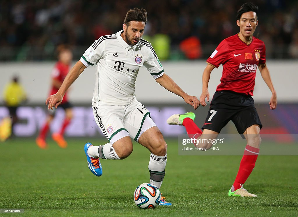 Junyan Feng of Guangzhou Evergrande FC chases Claudio Pizarro of Bayern Muenchen during the FIFA Club World Cup Semi Final match between Guangzhou Evergrande FC and Bayern Muenchen at the Agadir Stadium on December 17, 2013 in Agadir, Morocco.