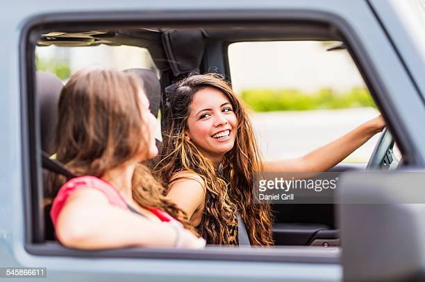 USA, Jupiter, Florida, Female friends (14-15) during road trip