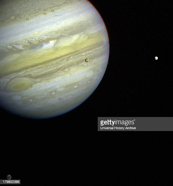 Jupiter its Great Red Spot and three of its four largest satellites are visible in this photo taken Feb 5 by Voyager 1