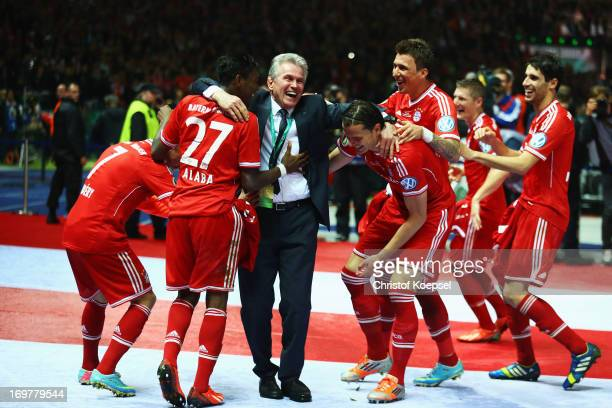 Jupp Heynckes head coach of Bayern Muenchen celebrates victory with his players in his last match after the DFB Cup Final match between FC Bayern...