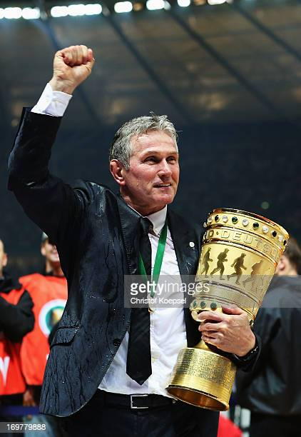 Jupp Heynckes head coach of Bayern Muenchen holds the trophy to celebrate victory in his last match after the DFB Cup Final match between FC Bayern...