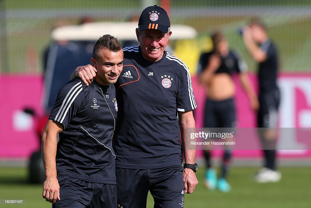 Jupp Heynckes, head coach of Bayern Muenchen, talks to his palyer Xherdan Shaqiri during a FC Bayern Muenchen training session ahead of their UEFA Champions League group F match against Valencia CF at the Saebener Strasse training ground on September 18, 2012 in Munich, Germany.