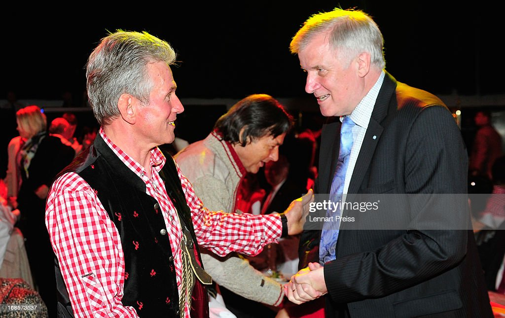 Jupp Heynckes (R), head coach of Bayern Muenchen, talks to Minister-President of Bavaria Horst Seehofer during the Official Champion dinner after winning the German championship at Postpalast on May 12, 2013 in Munich, Germany.