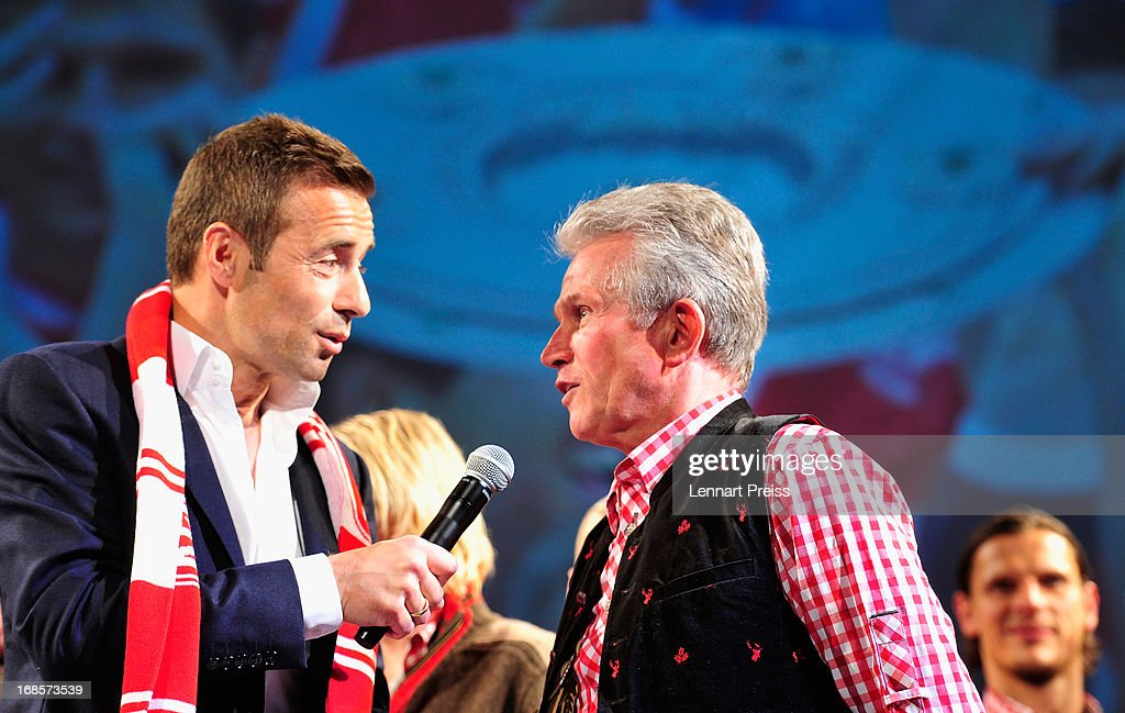 Jupp Heynckes (R), head coach of Bayern Muenchen, talks to presenter Kai Pflaume during the Official Champion dinner after winning the German championship at Postpalast on May 12, 2013 in Munich, Germany.