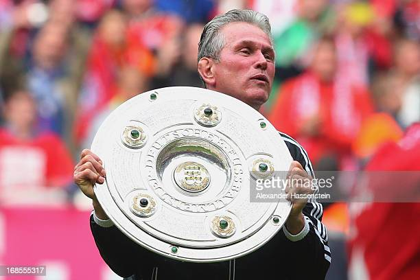 Jupp Heynckes head coach of FC Bayern Muenchen celebrates with the Bundesliga trophy following his team's match against Augsburg at the Allianz Arena...