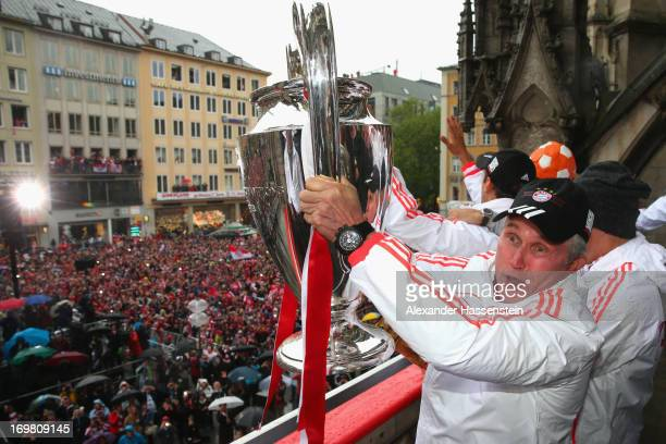Jupp Heynckes head coach of FC Bayern Muenchen celebrates with the Champions League winners trophy on the town hall balcony at Marienplatz on June 2...