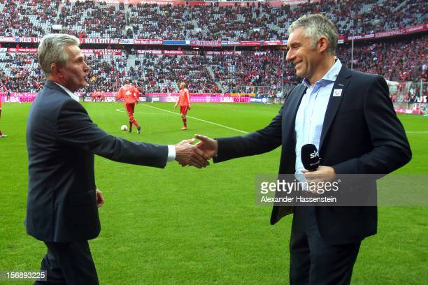 Jupp Heynckes head coach of Muenchen talks to Mirko Slomka head coach of Hannover prior the Bundesliga match between FC Bayern Muenchen and Hannover...