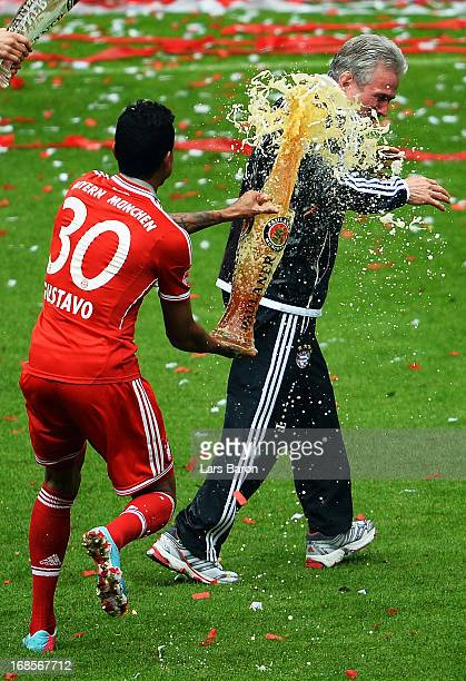 Jupp Heynckes the Head Coach of FC Bayern Muenchen is drenched in beer by Luiz Gustavo after the Bundesliga match between FC Bayern Muenchen and FC...