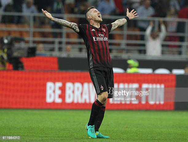 Juraj Kucka of AC Milan celebrates a victory at the end of the Serie A match between AC Milan and US Sassuolo at Stadio Giuseppe Meazza on October 2...