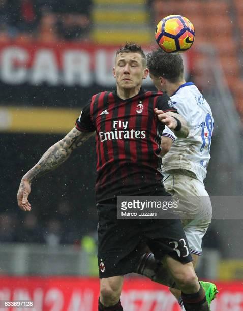 Juraj Kucka of AC Milan competes for the ball with Dennis Praet of UC Sampdoria during the Serie A match between AC Milan and UC Sampdoria at Stadio...