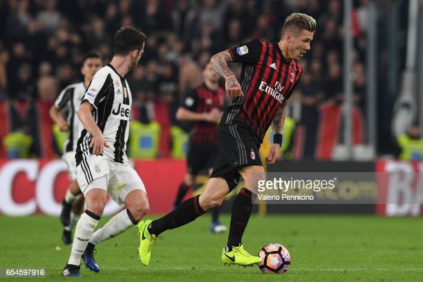 Juraj Kucka of AC Milan in action against Miralem Pjanic of Juventus FC during the Serie A match between Juventus FC and AC Milan at Juventus Stadium...