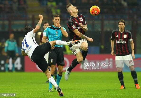 Juraj Kucka of AC Milan is challenged by Luca Cigarini of Atalanta BC during the Serie A match between AC Milan and Atalanta BC at Stadio Giuseppe...