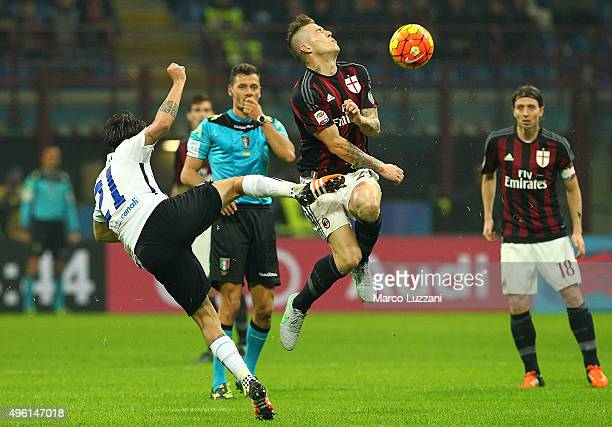 Juraj Kucka of AC Milan is challenged by Luca Cigarini of Atalanta BC during the Serie A match between AC Milan and Atalanta BC at Stadio Giuseppe...