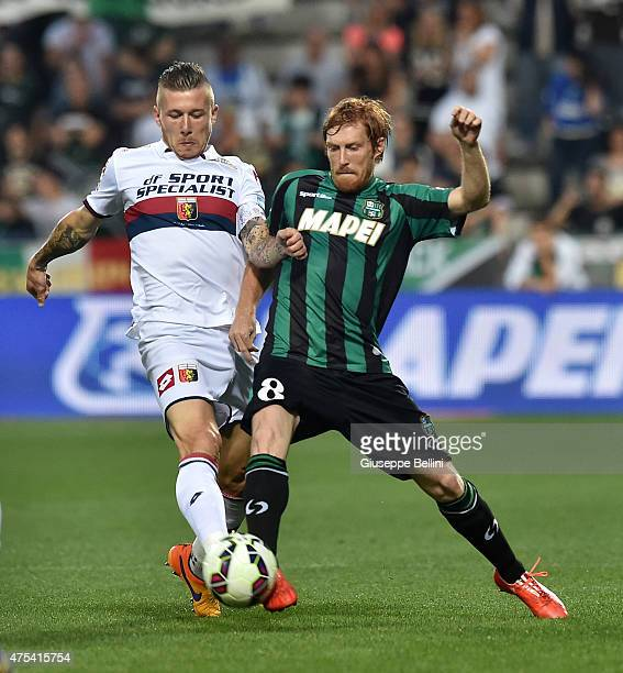 Juraj Kucka of Genoa and Davide Biondini of Sassuolo in action during the Serie A match between US Sassuolo Calcio and Genoa CFC at Mapei Stadium on...