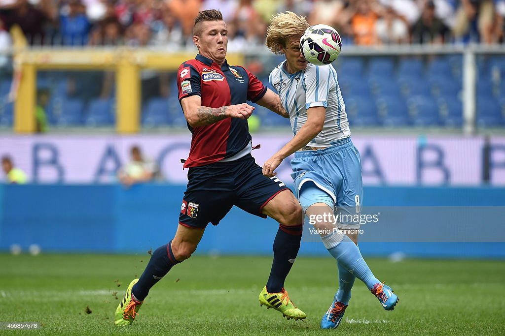 <a gi-track='captionPersonalityLinkClicked' href=/galleries/search?phrase=Juraj+Kucka&family=editorial&specificpeople=6388600 ng-click='$event.stopPropagation()'>Juraj Kucka</a> (L) of Genoa CFC competes with Dusan Basta of SS Lazio during the Serie A match between Torino FC and Hellas Verona FC at Stadio Olimpico di Torino on September 21, 2014 in Turin, Italy.