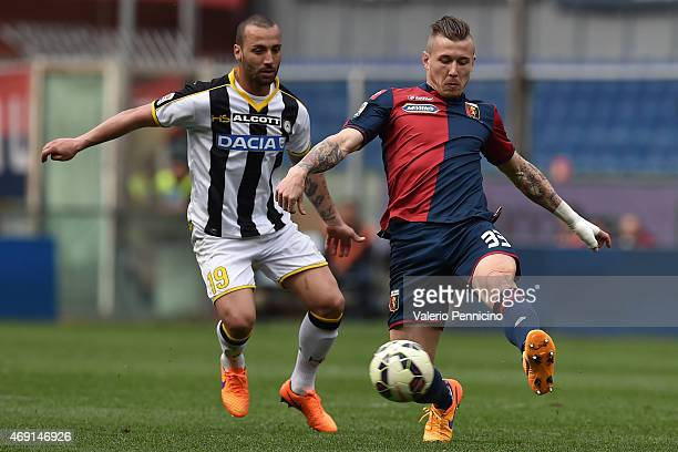 Juraj Kucka of Genoa CFC in action against Dos Santos Guilherme of Udinese Calcio during the Serie A match between Genoa CFC and Udinese Calcio at...
