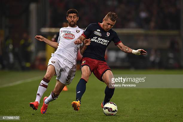 Juraj Kucka of Genoa CFC is challenged by Marco Benassi of Torino FC during the Serie A match between Genoa CFC and Torino FC at Stadio Luigi...