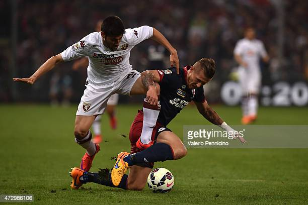 Juraj Kucka of Genoa CFC tussles for possession with Marco Benassi of Torino FC during the Serie A match between Genoa CFC and Torino FC at Stadio...