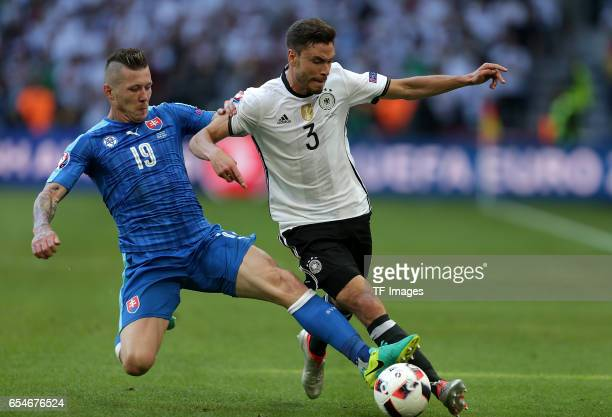 Juraj Kucka of Slovakia and Jonas Hector of Germany battle for the ball during the UEFA EURO 2016 round of 16 match between Germany and Slovakia at...