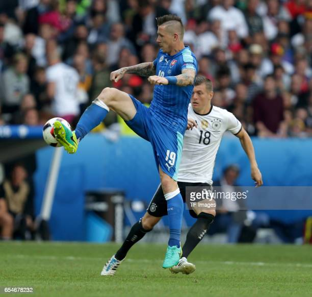 Juraj Kucka of Slovakia and Toni Kroos of Germany battle for the ball during the UEFA EURO 2016 round of 16 match between Germany and Slovakia at...
