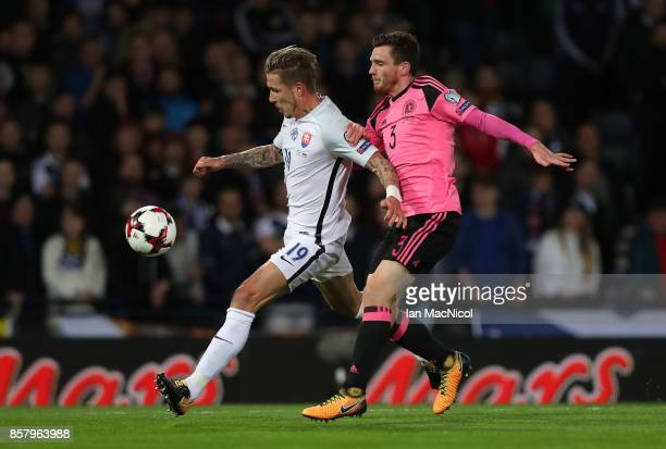 Juraj Kucka of Slovakia vies with Andy Robertson of Scotland during the FIFA 2018 World Cup Qualifier between Scotland and Slovakia at Hampden Park...