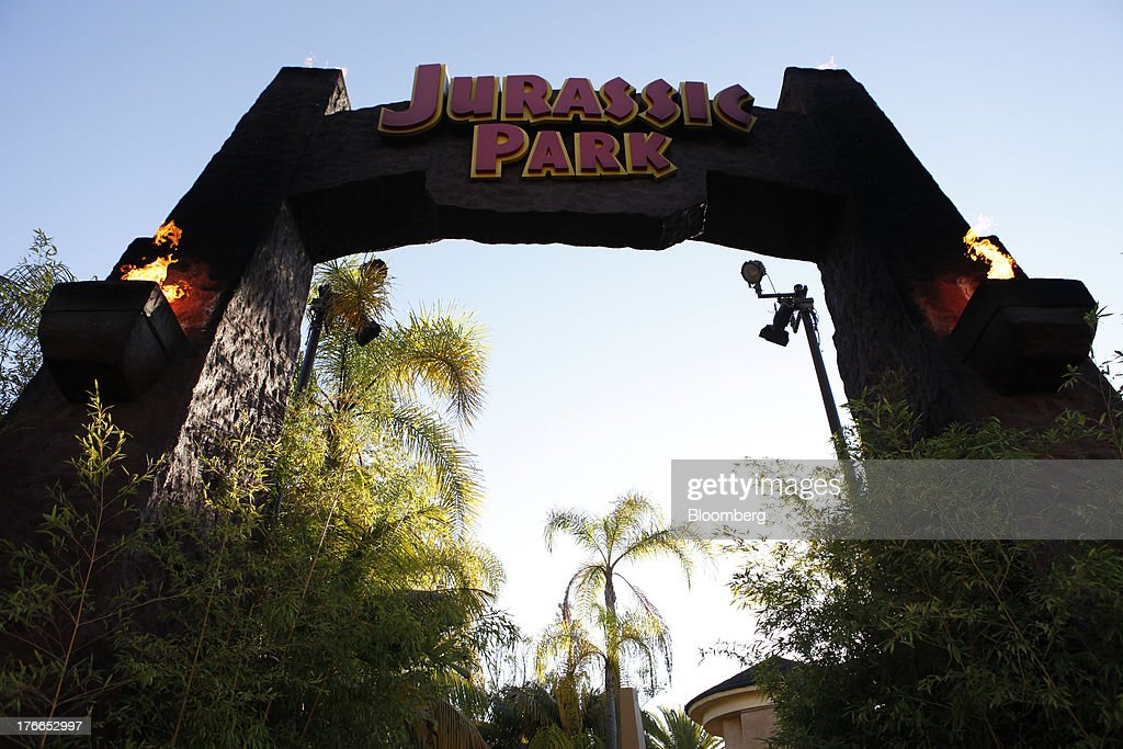 'Jurassic Park: The Ride' signage is displayed at the Universal Studios Hollywood theme park in Hollywood, California, U.S., on Thursday, Aug. 15, 2013. NBC Universal, majority owned by Comcast Corp., operates some of the most-watched U.S. cable TV channels, in addition to its flagship broadcast network, a film studio and the Universal Studios amusement parks. Photographer: Patrick T. Fallon/Bloomberg via Getty Images