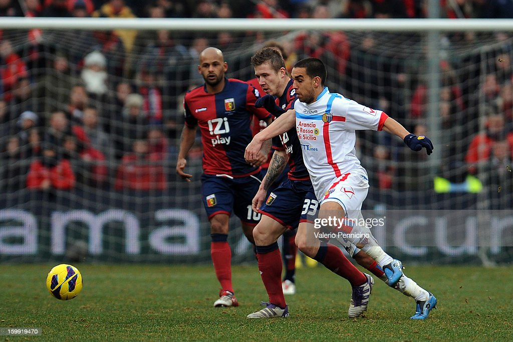 Juray Kucka (L) of Genoa CFC competes with Giuseppe Bellusci of Calcio Catania during the Serie A match between Genoa CFC and Calcio Catania at Stadio Luigi Ferraris on January 20, 2013 in Genoa, Italy.