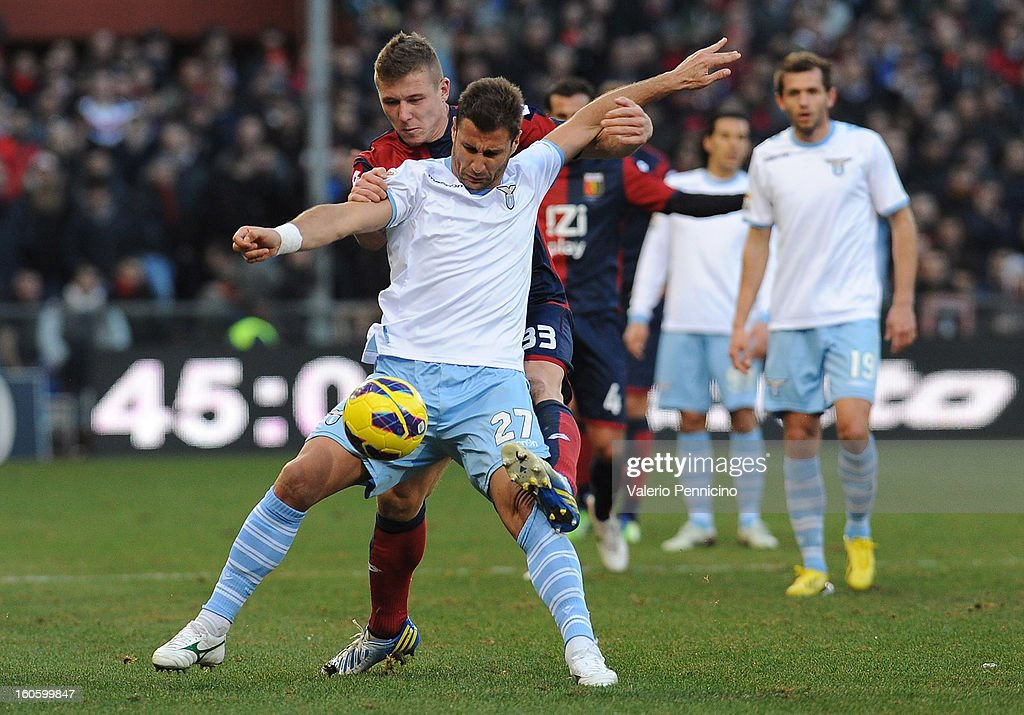 Juray Kucka (L) of Genoa CFC competes with Lorik Cana of S.S. Lazio during the Serie A match between Genoa CFC and SS Lazio at Stadio Luigi Ferraris on February 3, 2013 in Genoa, Italy.